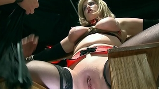 Mature slave blonde gets hot wax on her clit