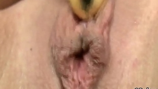 Elegant nympho is opening up tight vagina in closeup and having orgasm
